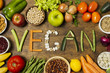 canvas print picture - Flat lay vegan word with vegetable letters