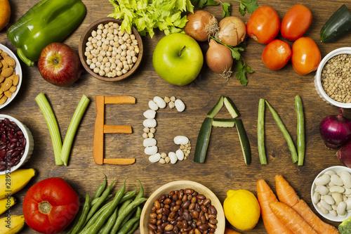 Obraz Flat lay vegan word with vegetable letters - fototapety do salonu