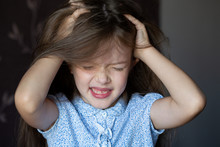 The Girl Is Crying, Grabbed Her Head, A Child's Problems. The Girl Scratches Her Head, Severe Itching, Infection With Lice