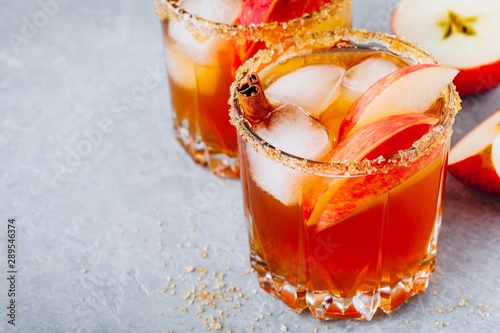 Apple cider margarita with cinnamon and ice for Halloween or Thanksgiving in gla Canvas Print