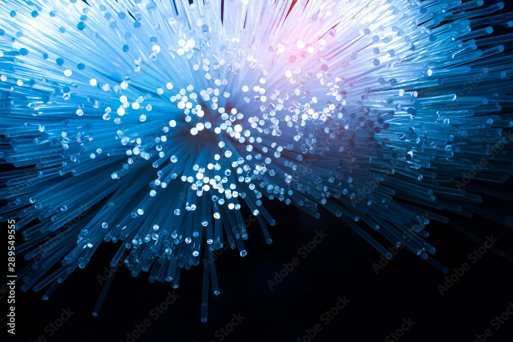 Fototapeta fiber optics network cable for ultra fast internet communications, thin light threads that move information at high speed.