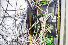 Many TV Wires Randomly Intermingle Among Themselves In The Racks Of The Server Room Of The TV Station. Telecommunication Equipment Of A Cable Television Provider.