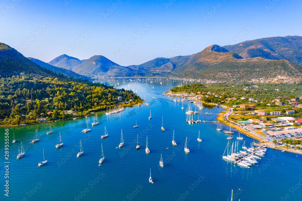 Fototapety, obrazy: Aerial drone bird's eye view photo of iconic port of Nidri or Nydri, Leflkada island, Ionian, Greece
