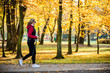 canvas print picture - Nordic walking - middle-age woman working out in city park