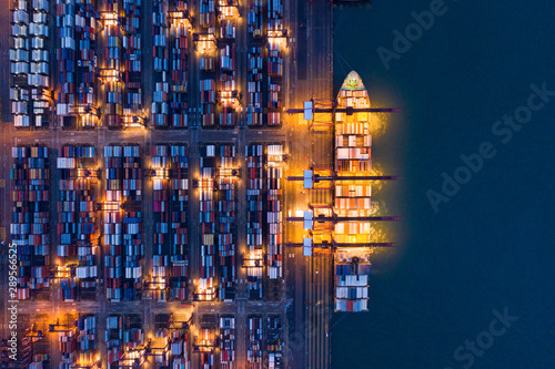 Poster Hong-Kong Aerial top view of container cargo ship in the export and import business and logistics international goods in urban city. Shipping to the harbor by crane in Victoria Harbour, Hong Kong City at night.