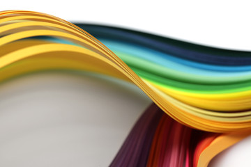 Abstract rainbow gradient color wave curl strip paper background. Soft focus.