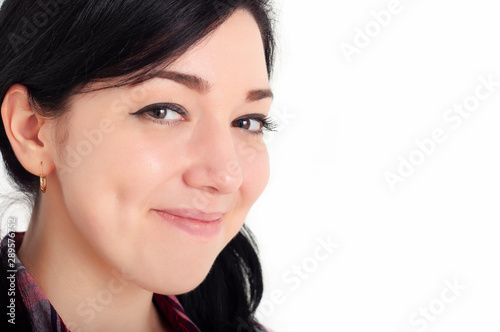 A young joyful beautiful brunette girl with cute dimples on her cheeks smile and looks at the camera with happiness in her eyes Fototapet