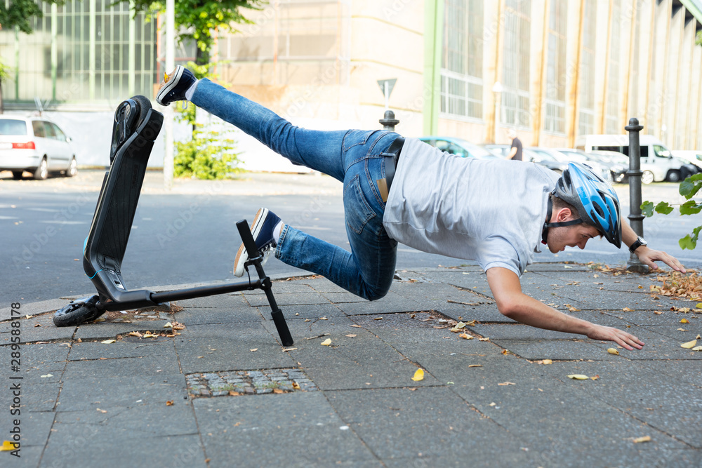 Fototapety, obrazy: Man Falling From E-Scooter