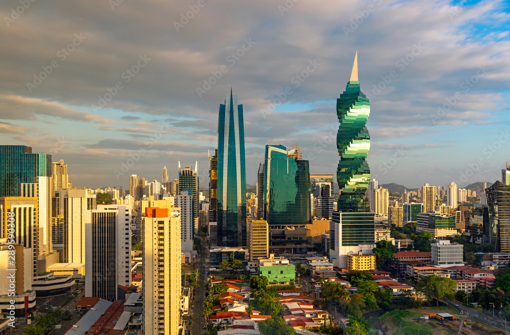 Fototapety, obrazy: The colorful panoramic skyline of Panama City at sunset with high rise skyscrapers, Panama, Central America.