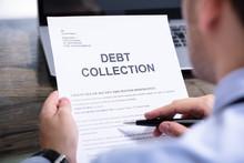 Man Reading Debt Collection Le...