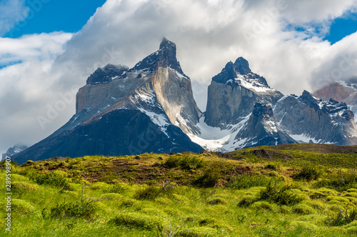 The Andes mountain range peaks of the Cuernos del Paine in their full glory inside the Torres del Paine national park near Puerto Natales, Patagonia, Chile Fototapet
