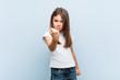 Leinwandbild Motiv Cute girl showing fist to camera, aggressive facial expression.