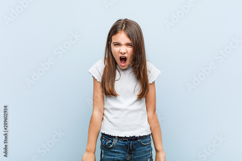 Cute girl screaming very angry and aggressive.
