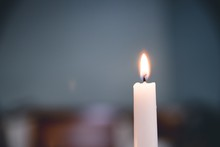 Selective Focus Closeup Shot Of Lighted White Candle