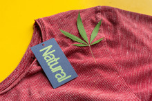 Eco Organic Clothes Made Of The Cannabis Material On A Color Surface With A Hemp Leaf