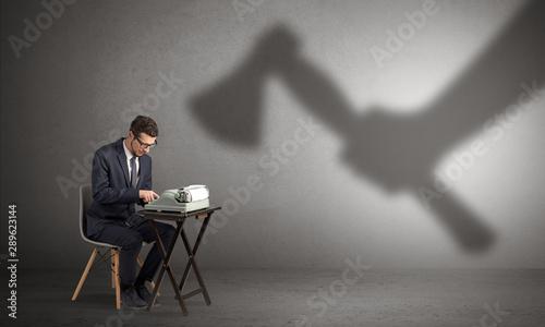 Fotografía Shadow threatening hard worker man who is afraid