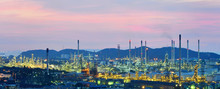 Oil Refinery , Petrochemical Industrial With City Background At Sunset , Si Racha District, Chon Buri , Thailand