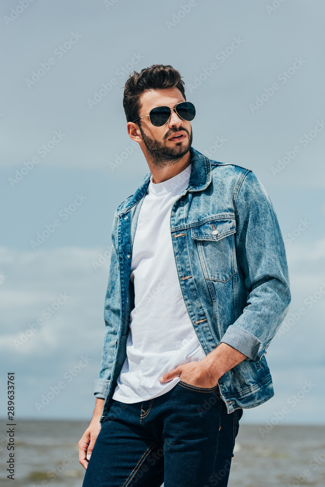 Fototapety, obrazy: handsome man in denim jacket and sunglasses looking away