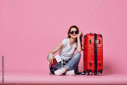 young woman with suitcase Fotobehang