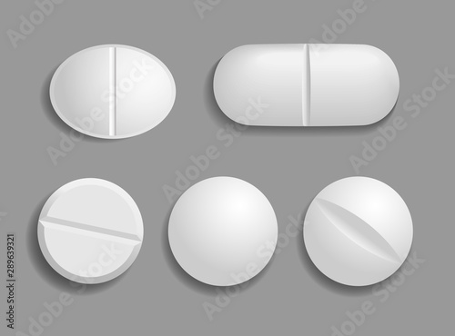 Fototapeta Set of medical white tablets. Flat and convex pills in 3D style with shadow are isolated on gray background. Top view. Realistic vector illustration obraz na płótnie
