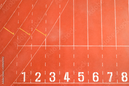 Foto auf Leinwand Koralle Start and Finish point of race track or athletics track start line with lane numbers Top view Drone shot high angle view