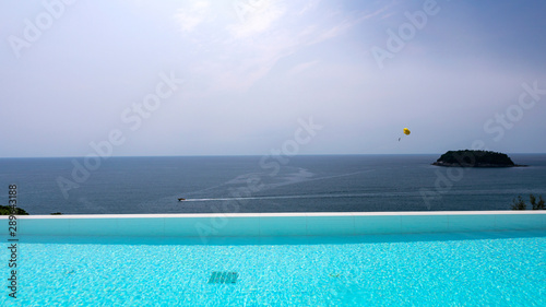 Foto auf Leinwand Turkis Swimming pool overlooking view andaman sea Small island and blue sky background,summer holiday background concept