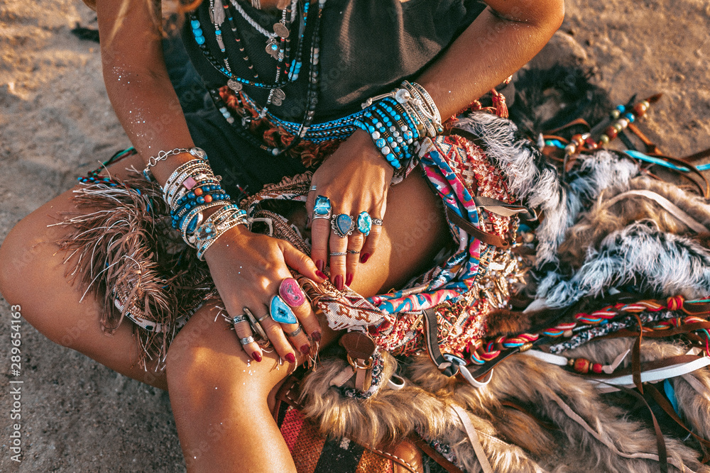 Fototapety, obrazy: close up of young boho style woman sitting on sand on the beach at sunset
