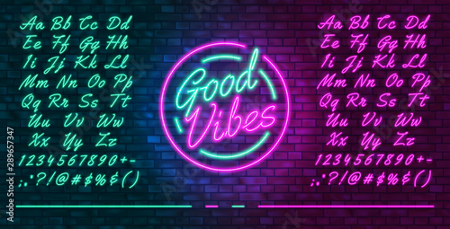 Obraz Neon futuristic font, luminous blue and pink uppercase and lowercase letters, colorful bright neon hand drawn typeface, glowing sign Good vibes, vector illustration - fototapety do salonu