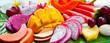 canvas print picture - Tropical fruits assortment, palm leaf background. Close up.