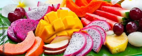 Tropical fruits assortment, palm leaf background. Close up. - 289663301