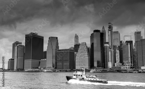 View of Manhattan and a police boat