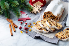 Christmas Stollen Cake With Icing Sugar, Marzipan And Raisins. Traditional Dresdner Christ Pastry. Marble Background.