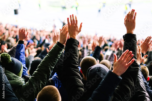 Football fans clapping on the podium of the stadium - 289671561