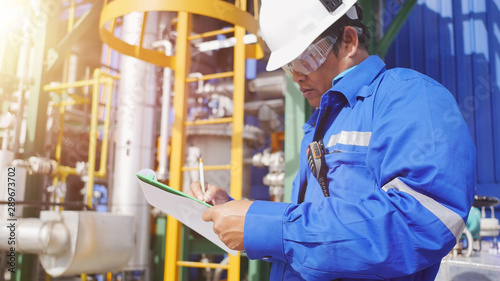 Pinturas sobre lienzo  Production engineer to working in petroleum refinery plant to check equipment in