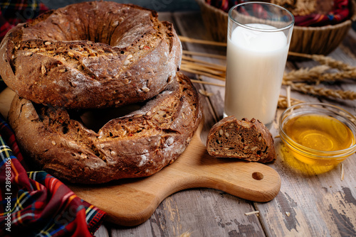 Brown bread in rustic style background