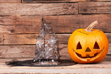 Halloween Holiday Background. Halloween Pumpkin Jack-O-Lantern Head And Witch Head On Wooden Background. Halloween Celebration Party.