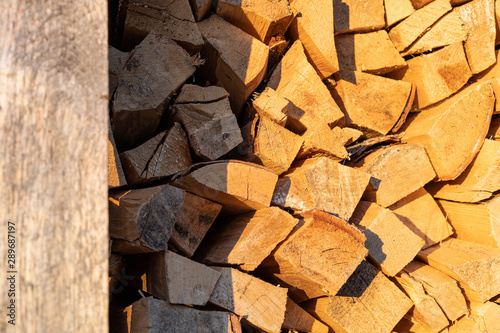 Firewood background at sunset, rural concept