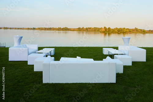 Lounge area for guests outside. White sofas and tables Fototapeta