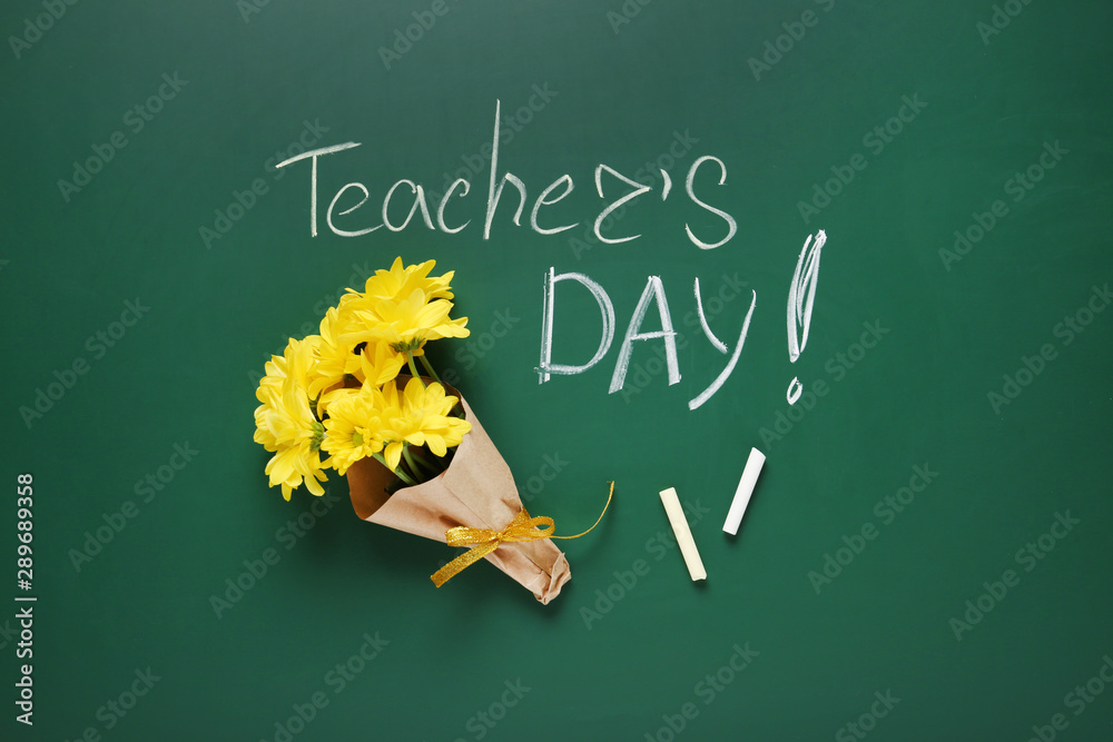 Fototapeta Flat lay composition with flowers and inscription TEACHER'S DAY on green chalkboard