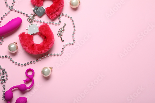 Set of different sex toys and Christmas decorations on pink background, flat lay. Space for text - 289690155