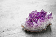 Beautiful Purple Amethyst Gemstone On Grey Table, Space For Text