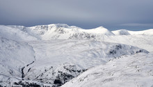 The Snow Covered Summits Of He...