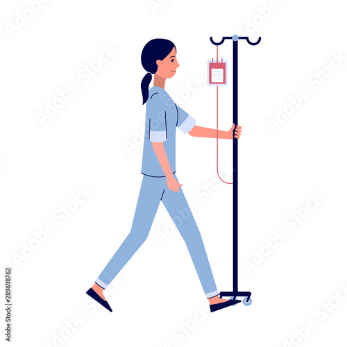 Cartoon nurse walking with IV bag full of blood on IV pole - fototapety na wymiar