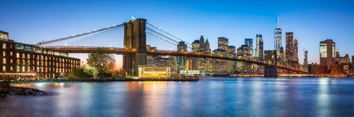 Brooklyn Bridge panorama with Manhattan skyline in New York City, USA