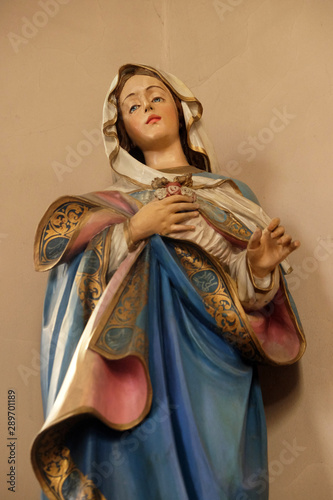 Fototapeta Immaculate Heart of Mary, statue on the altar in the church of Saint Martin in Zagreb, Croatia obraz na płótnie