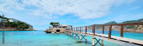 Wooden walkway leading across turquoise Mediterranean Sea panoramic image Wallpaper Mural