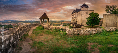 Tuinposter Oude gebouw The inner Gothic castle in Trencin Slovakia with Renaissance palace and castle gate dramatic stormy sky