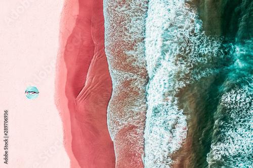 Obraz Aerial View Of Woman On Pink Ocean Beach - fototapety do salonu