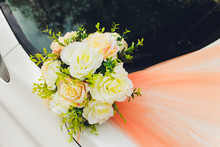 Wedding Bouquet Bridal Decoration On Luxury White Car.