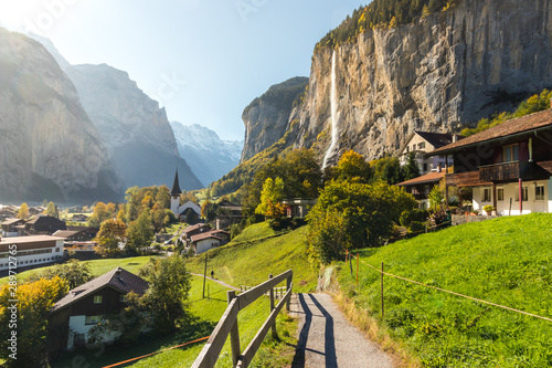 Fototapeta Lauterbrunned is the small village in valley with beautiful waterfall from the mountain obraz